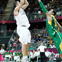 31 July 2012: Great Britain Nate Reinking takes a jumpshot over Marquinhos Vieira Sousa during 67-62 Team Brazil victory over Team Great Britain, during the men's basketball preliminary, at the Basketball Arena, in London, Great Britain.