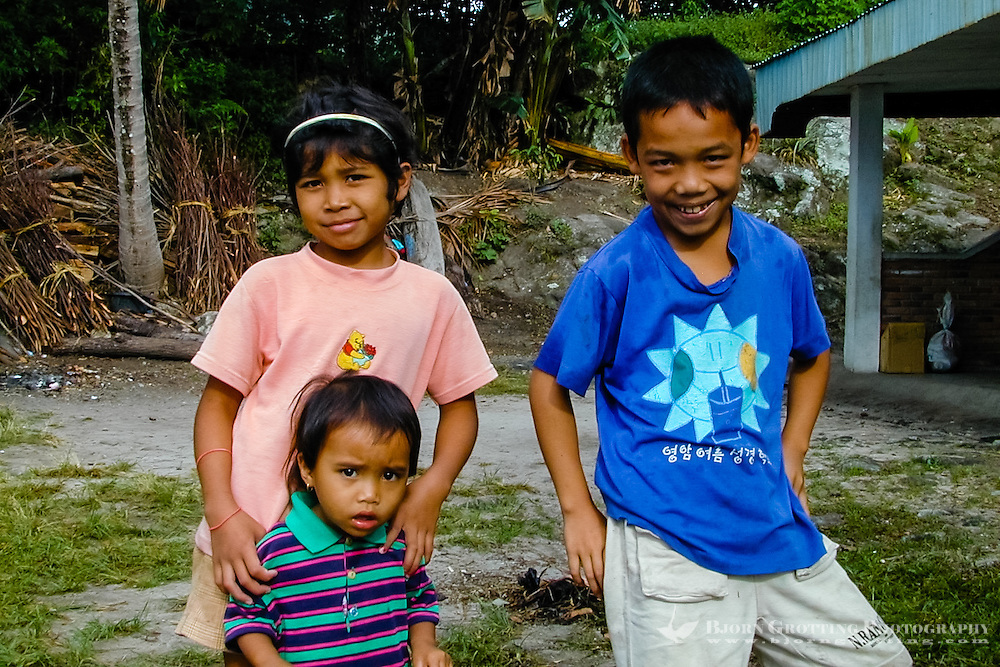 Indonesia, Sumatra. Samosir. Batak kids in Tuk Tuk. Tuk Tuk is today full of hotels and restaurants, and a good base to explore the rest of Samosir.