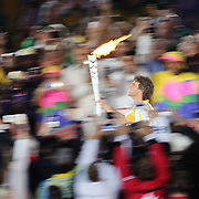 Opening Ceremony 2016 Olympic Games: Gustavo Kuerten carriers the Olympic torch through the stadium before handing over to Hortencia Marcari during the spectacular opening ceremony for the 2016 Olympic Games on August 5, 2016 in Rio de Janeiro, Brazil. (Photo by Tim Clayton/Corbis via Getty Images)