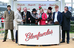Jockey Keith Donoghue and winning connections including Michael O'Leary (second left) following victory aboard Tiger Roll in the Glenfarclas Chase during Ladies Day of the 2019 Cheltenham Festival at Cheltenham Racecourse.