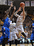 WICHITA, KS - JANUARY 18:  Guard Ron Baker #31 of the Wichita State Shockers drives in for a basket against guard Demetrius Moore #15 of the Indiana State Sycamores during the first half on January 18, 2014 at Charles Koch Arena in Wichita, Kansas.  (Photo by Peter Aiken/Getty Images) *** Local Caption *** Ron Baker;Demetrius Moore