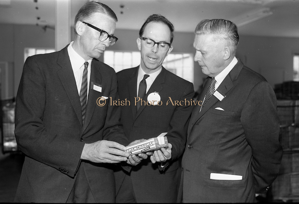 8/9/1964<br /> 9/8/1964<br /> 8 September 1964<br /> <br /> Mr. Lynch, Mr Kerrigan of Urney Chocolates and Mr. Dyer of the Vancouver Sun looking over some of the finished product