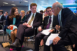 © Licensed to London News Pictures. 09/06/2014. LONDON, UK. Miriam Clegg, Danny Alexander and Vince Cable (R) listening Liberal Democrat party leader Nick Clegg's speech on party's long term vision in coalition and policies at Bloomberg in central London on Monday, 9 June 2014. Photo credit : Tolga Akmen/LNP