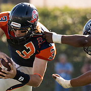 11/5/163:04:43 PM --- Football --- Orange Coast College quarterback Kody Whitaker (3) is tackled by Fullerton College linebacker Roy Oto (51) during a game at LeBard Stadium in Costa Mesa, CA.