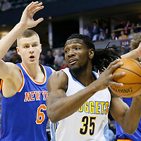 08 March 2016: Denver Nuggets forward Kenneth Faried (35) drives past New York Knicks forward Kristaps Porzingis (6) and New York Knicks center Robin Lopez (8) during the Denver Nuggets 110-94 victory over the New York Knicks, at the Pepsi Center, Denver, Colorado, USA.