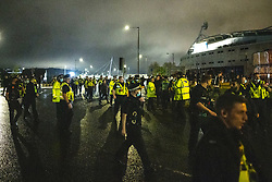 © Licensed to London News Pictures. 09/05/2021. Bolton, UK. Dozens of police officers arrive at the scene . Bolton Wonderers supporters celebrate outside the University of Bolton stadium as their team coach returns home following BWFC winning promotion to League One after the team's 1-4 victory over Crawley Town . Photo credit: Joel Goodman/LNP