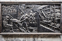 """Bas Relief at Hoa Loa, Hanoi Hilton Prison - The original purpose of Hoa Loa Prison or the """"Hanoi Hilton""""<br /> was for the French colonial system detaining of Vietnamese criminals which usually meant anti-colonial activists seen as heroes by the Vietnamese'.The prisoners themselves named it Hoa Lo meaning 'fiery furnace"""".   After the French left it was used to incarcerate a new line of inmates. During the American War, US forces pilots were detained in the during its period serving as a prisoner of war camp.  During the Vietnam War  the prison got a new nickname: the Hanoi Hilton.  Memoirs by former inmates speak of torture, murder and medical neglect.  The Vietnamese maintain that American prisoners were well treated.  Surviving the Hanoi Hilton boosted the career of US Republican Senator from Arizona John McCain."""
