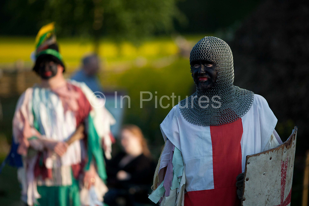 Men dressed as knights re-enactors doing a pretend battle, perform for crowds visitors, english traditions. The annual Beltane celebrations at Butser ancient farm, Hampshire, marking the beginning of the British summer.