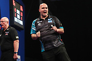 Rob Cross hits a double and wins the match against Jamie Hughes during the Grand Slam of Darts, at Aldersley Leisure Village, Wolverhampton, United Kingdom on 11 November 2019.