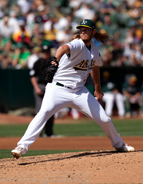 Oakland Athletics pitcher A.J. Puk (31) delivers against the Texas Rangers during the fourth inning of a baseball game, Sunday, Sept. 22, 2019, in Oakland, Calif. (AP Photo/D. Ross Cameron)
