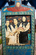 The  Merry Cemetery ( Cimitirul Vesel ),  Săpânţa, Maramares, Northern Transylvania, Romania.  The naive folk art style of the tombstones created by woodcarver  Stan Ioan Pătraş (1909 - 1977) who created in his lifetime over 700 colourfully painted wooden tombstones with small relief portrait carvings of the deceased or with scenes depicting them at work or play or surprisingly showing the violent accident that killed them. Each tombstone has an inscription about the person, sometimes a light hearted  limerick in Romanian. .<br /> <br /> Visit our ROMANIA HISTORIC PLACXES PHOTO COLLECTIONS for more photos to download or buy as wall art prints https://funkystock.photoshelter.com/gallery-collection/Pictures-Images-of-Romania-Photos-of-Romanian-Historic-Landmark-Sites/C00001TITiQwAdS8
