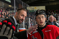 KELOWNA, BC - DECEMBER 30:  Jack Sander #17 of the Prince George Cougars stands on the bench and listens to assistant coach Jason Smith against the Kelowna Rockets at Prospera Place on December 30, 2019 in Kelowna, Canada. (Photo by Marissa Baecker/Shoot the Breeze)