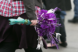 © Licensed to London News Pictures. 18/01/2015. Measham, Leicestershire, UK. The scene outside St Laurence's Church in the centre of Measham for the service of Kayleigh Haywood. Pictured, flowers in Kayleigh's favourite colour purple. Photo credit : Dave Warren/LNP