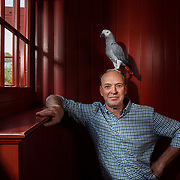 Robert Dalrymple, with his wife Anna, at their home in Gifford, near Edinburgh with their pet parrot called William.   Picture Robert Perry for Country Life 14th August 2019