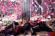 Owners of a shop in Hanoi are resting during a fair, Vietnam, Southeast Asia
