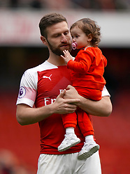 Arsenal's Shkodran Mustafi and daughter on the pitch after the final whistle of the Premier League match at the Emirates Stadium, London.
