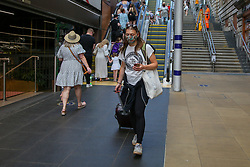 © Licensed to London News Pictures. 16/07/2021. Edinburgh, Scotland, UK. A commuter wearing a face covering at Edinburgh Waverley station. From Monday 19 July, wearing face coverings on public transport in England will no longer be a legal requirement. However, passengers travelling in Scotland and Wales will be required to wear face coverings on public transport beyond July 19. Photo credit: Dinendra Haria/LNP