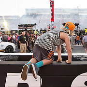 A young boy crosses the track barrier at Bristol Motor Speedway after the singing of the National Anthem.