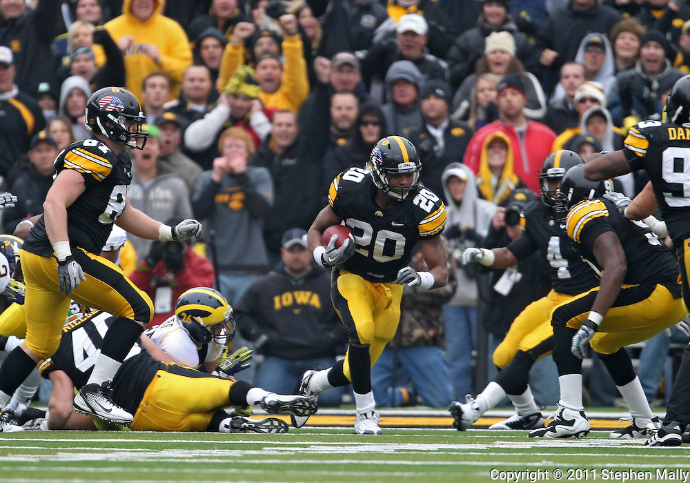 November 05, 2011: Iowa Hawkeyes linebacker Christian Kirksey (20) runs with the ball after an interception during the second quarter of the NCAA football game between the Michigan Wolverines and the Iowa Hawkeyes at Kinnick Stadium in Iowa City, Iowa on Saturday, November 5, 2011. Iowa defeated Michigan 24-16.