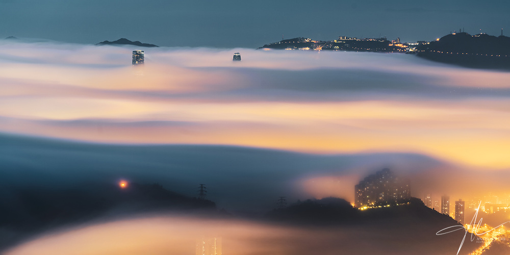 Multiple layers of cloud hovering above the city of Hong Kong, orchestrated a beautiful feast of colours and motion.
