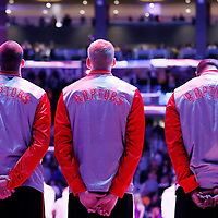 30 November 2014: Toronto Raptors players stand during the national anthem prior to the Los Angeles Lakers 129-122 overtime victory over the Toronto Raptors, at the Staples Center, Los Angeles, California, USA.