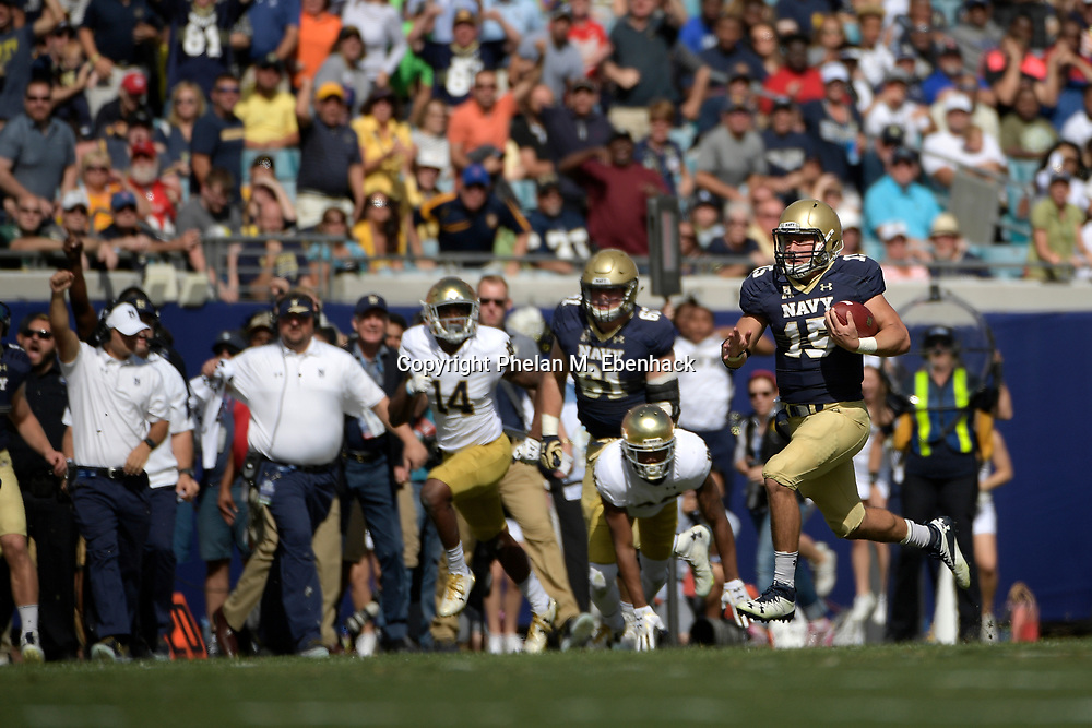 Navy quarterback Will Worth (15) rushes for a long gain during the first half of an NCAA college football game against Notre Dame in Jacksonville, Fla., Saturday, Nov. 5, 2016. (Photo by Phelan M. Ebenhack)
