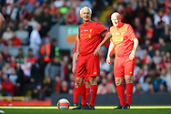 Ian Rush of Liverpool legends team checks the clock to see how long is left to play. Liverpool Legends  v Real Madrid Legends, Charity match for the LFC Foundation at the Anfield stadium in Liverpool, Merseyside on Saturday 25th March 2017.<br /> pic by Chris Stading, Andrew Orchard sports photography.