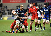 Sale Sharks No.8 Daniel Du Preez drives through the Leicester Tigers defence during a Gallagher Premiership Rugby Union match Sale Sharks -V- Leicester Tigers, Sale won the match 36-3 on Friday, Feb. 21, 2020, in Eccles, United Kingdom. (Steve Flynn/Image of Sport via AP)