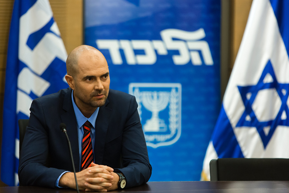 Amir Ohana, head of the LGBT-equality group in the right-wing Likud party, attends a Likud party faction meeting at the Knesset, Israel's parliament in Jerusalem, on December 21, 2015. Ohana is slated to the first gay right-wing Knesset Member and the first openly gay man from the Likud party to serve in the Knesset, following the resignation of Silvan Shalom (not pictured).
