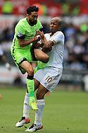 Gael Clichy of Manchester city (l) collides into Andre Ayew of Swansea city (r). Barclays Premier league match, Swansea city v Manchester city at the Liberty Stadium in Swansea, South Wales on Sunday 15th May 2016.<br /> pic by Andrew Orchard, Andrew Orchard sports photography.