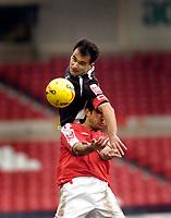 Photo: Leigh Quinnell.<br /> Nottingham Forest v Swansea. Coca Cola League 1. 11/02/2006. Swansea captain Roberto Martinez rises above Nottingham Forests Jack Lester.