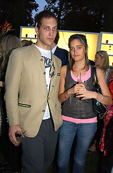 LORD FREDERICK WINDSOR and VIOLET VON WESTENHOLTZ at the Quintessentially Summer Party held at Debenham House, 8 Addison Road, London W14 on 15th June 2006.<br />