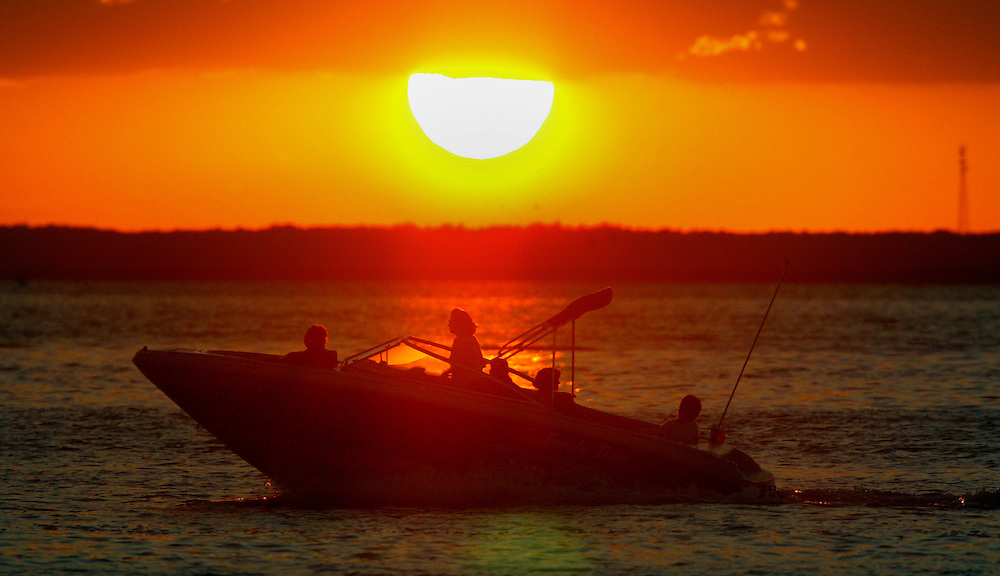 (DITLO) Long Brach Twp 8/8/2002  A boat passes as the sun sets on Barnegat Bay.  This photo taken from Bayview Park.  .    Michael J. Treola Staff Photographer.....MJT