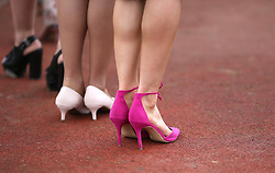 A detailed view of Female racegoers taking part in the Miss Cheltenham finalists line up during Ladies Day of the 2018 Cheltenham Festival at Cheltenham Racecourse. PRESS ASSOCIATION Photo. Picture date: Wednesday March 14, 2018. See PA story RACING Cheltenham. Photo credit should read: Steven Paston/PA Wire. RESTRICTIONS: Editorial Use only, commercial use is subject to prior permission from The Jockey Club/Cheltenham Racecourse.