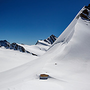 Mountain hut on the back face of the Eiger (3,970m), Jungfrau (4,158m) and Mönch (4,107m) peaks in the Bernese Oberland, Switzerland. Great location for climbers, walkers and mountain enthusiasts from serious to amateur.