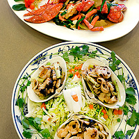 Surf Clams, foreground, and Stuffed Lobster are frequently served up at the Sinh Sinh restaurant on Bellaire.  (Photo by Kim Christensen)