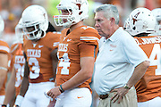 AUSTIN, TX - AUGUST 31: Head coach Mack Brown of the Texas Longhorns stands next to quarterback David Ash #14 before kickoff against the New Mexico State Aggies on August 31, 2013 at Darrell K Royal-Texas Memorial Stadium in Austin, Texas.  (Photo by Cooper Neill/Getty Images) *** Local Caption *** Mack Brown; David Ash