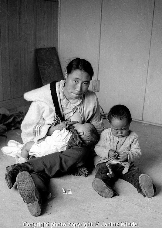 Inuit woman breatfeeding her baby  in the Canadian Arctic settlement of Pangnirtung in the territory of Nunavut (North West Territories) 1973