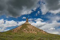 Chimney Rock  is a very distinctive rock formation south of Bayard, Nebraska. Rising 300 feet above the surrounding river valley, it is the most famous landmark along the Oregon Trail.
