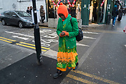 Colourful green and orange clothes on Whitechapel High Street in London, England, United Kingdom. (photo by Mike Kemp/In Pictures via Getty Images)