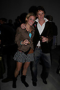 Tara Hacking and Eddie Redmayne. Almeida 25th Anniversay Gala. Gagosian Gallery, Brittania St. Kings Cross. London. 27 January 2005. ONE TIME USE ONLY - DO NOT ARCHIVE  © Copyright Photograph by Dafydd Jones 66 Stockwell Park Rd. London SW9 0DA Tel 020 7733 0108 www.dafjones.com