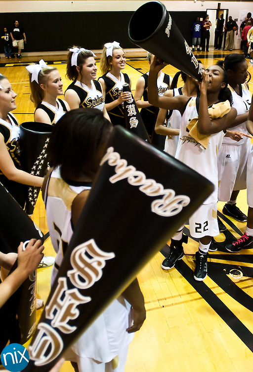 The Concord Lady Spiders celebrate their win against Charlotte Catholic during the second round of NCHSAA 3-A Playoffs Wednesday night at Concord High School. Concord won 62-33 to advance. (Photo by James Nix)