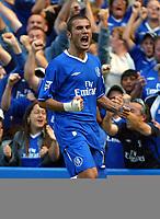 Photograph: Scott Heavey.<br />Chelsea v Blackburn Rovers. FA Barclaycard Premiership match from Stamford Bridge. 30/08/2003.<br />Adrian Mutu celebrates after bringing the scores level.