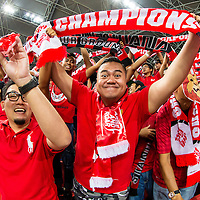 Singapore fans cheer prior to the group stage match of the AFF Suzuki Cup between Singapore and Malaysia at the National Stadium at the Singapore Sports Hub on November 29, 2014, in Singapore.