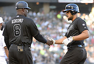 CHICAGO - AUGUST 24:  Jose Abreu #79 is greeted by first base coach Daryl Boston #8 of the Chicago White Sox after Abreu hit his 1000th Major League hit against the Texas Rangers during Players Weekend on August 24, 2019 at Guaranteed Rate Field in Chicago, Illinois.  (Photo by Ron Vesely)  Subject:   Jose Abreu; Daryl Boston