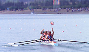 © 2000 All Rights Reserved - Peter Spurrier Sports Photo. .Tel 44 (0) 1784-440 771  .Mobile 44 (0) 973 819 551.email pictures@rowingpics.com.Sydney Olympics 2000 - Penrith Lakes, NSW...GBR M4- Gold medal winners wave to the family and friends enclosure. .......... Rowing Course: Penrith Lakes, NSW 2000 Olympic Regatta Sydney International Regatta Centre (SIRC) 2000 Olympic Rowing Regatta00085138.tif
