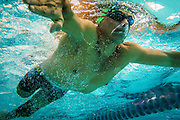 """2016/06/04 – Bogotá, Colombia: Moises Fuentes Garcia, 41, swims during a training session at the Simon Bolivar Aquatic Complex, Bogotá, 4th June, 2016. <br />  -<br /> Moises used to be a farmer and sell cattle with his brother when in October 1992, Paramilitaries in the region of Santa Marta targeted them. Moises was shot six times, and his brother killed. He was """"lucky"""" to survive, one of the bullets crossed his neck, and one stuck into his spine and he couldn't walk again. However it did not end there, a few months later, during a rehabilitation session he broke his leg and due to an infection he had to amputate it. Moises felt it wasn't worth living anymore. But after meeting a group of other victims that had even more severe injures, he grabbed life with will and began to feel motivated. He started playing wheelchair basketball and studying. In the process of the rehabilitation he was spotted as a good swimmer, even if he didn't possess any technique. After some success on the swimming pool, he became completely dedicated to the sport, while finishing degrees as a tailor, public accountant and hopes to graduate as a sport teacher next year. <br /> Among many achievements he won the Bronze medal in 2008 Paralympic Games in Beijing and Silver medal on the 2012 Paralympic Games in London on the 100 meters breaststroke category. He also became the World Champion at the 2013 World Swimming Championships. Moises hopes that in the Rio 2016 Paralympics, he will bring gold home. <br /> He believes that people must value their life, what they have and help people on the way. """"Everyone is a champion, but some people don't do the necessary to really became one"""" he says. (Eduardo Leal)"""