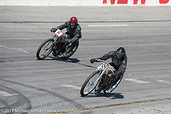 Xavier Muriel (red helmet,) the drummer of Buckcherry, on a 1914 Perry Mack on track with Rick Petko on his  1919 Indian Powerplus in Billy Lane's Son's of Speed race during Daytona Bike Week. New Smyrna Beach, FL. USA. Saturday March 18, 2017. Photography ©2017 Michael Lichter.