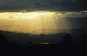 Central America, Honduras. Devastation in the aftermath of Hurricane Mitch. High winds and flooding. Calm after the storm. Sun rays through clouds over mountains.