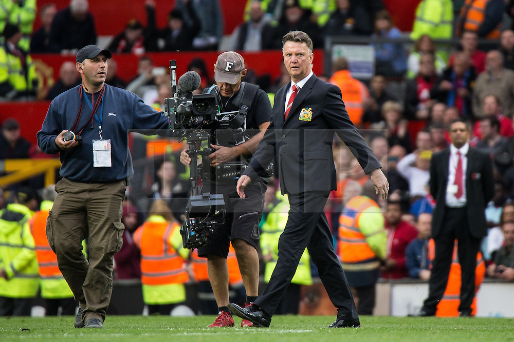 © Licensed to London News Pictures . 17/05/2015 .  Old Trafford , Manchester , UK . Manchester United manager Louis van Gaal on the pitch after the match . Manchester Utd vs Arsenal at Old Trafford Football Stadium , Manchester . Photo credit : Joel Goodman/LNP